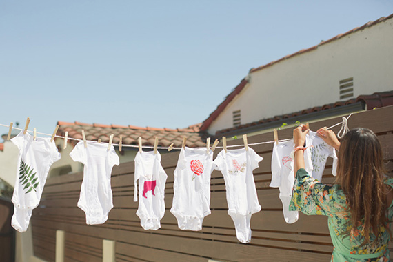 Hand-painted onesies at Kelly's bohemian baby shower by Bash Please | Lovechild Photography | 100 Layer Cakelet