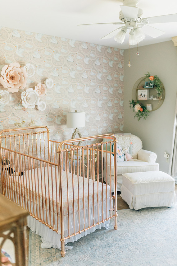 Vintage modern girl's nursery with rose gold crib